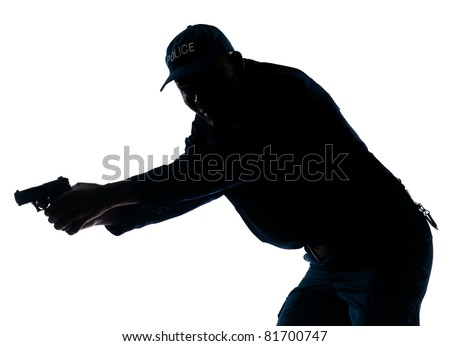 An afro American policeman holding handgun in studio on white isolated background - stock photo