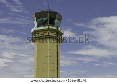 An air traffic control tower located around a blue sky. - stock photo
