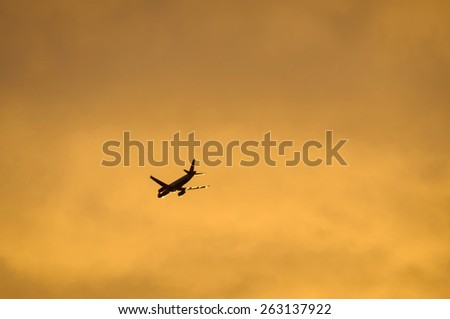 An airliner flying in the evening light - stock photo
