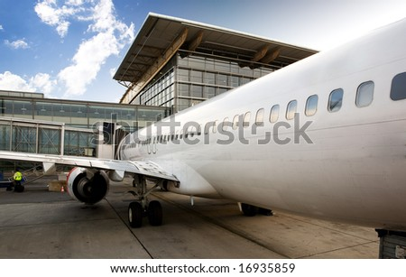 An airplane at a terminal gate ready for boarding - stock photo
