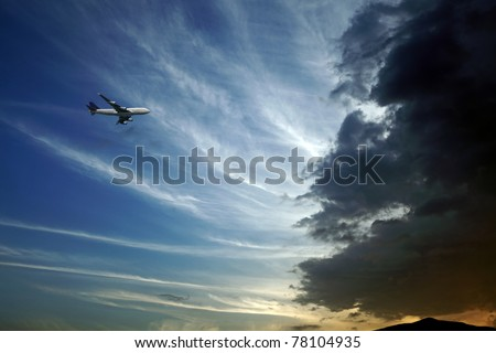 An airplane attempting to fly into a large volcanic ash cloud plume. - stock photo