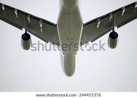 An airplane is seen taking off Melbourne airport. - stock photo