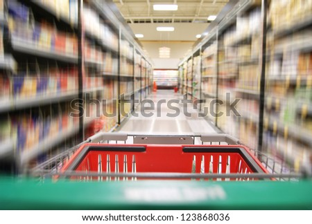 an aisle in a grocery store showing cereals and canned food - stock photo