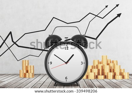 An Alarm clock is on the foreground and golden coins are on the background. Financial line graphs are drawn on the concrete wall. Wooden floor. The concept of time is money. 3D rendering. - stock photo