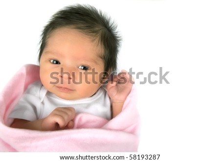 An alert newborn baby girl on a white background ith copy space - stock photo