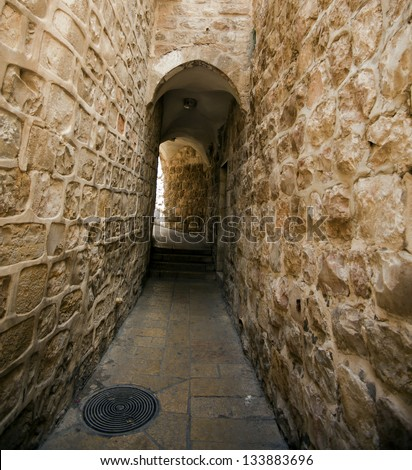 An alley in the Jewish quarter of the old city of Jerusalem, Israel. - stock photo
