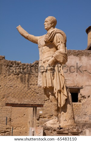 An almost intact Roman statue in the ruins of Herculaneum on the Bay of Naples, Italy - stock photo
