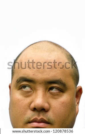 An alopecia bald head man glimpse up with white isolated background. He looks annoy and tired facial expression with wrinkle