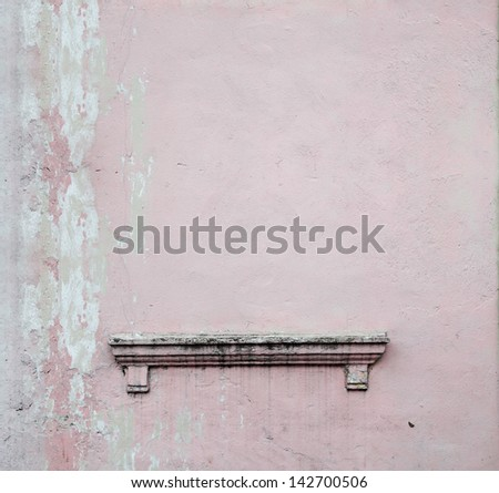 An altar on a blank weathered pink concrete wall with copy space for text.  - stock photo