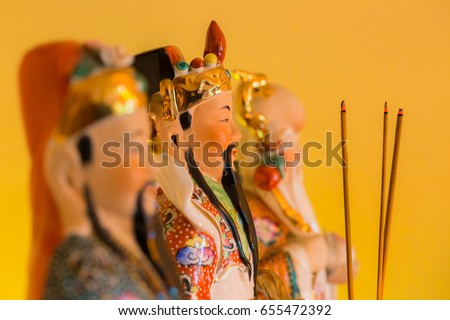 An altar with the Chinese house-gods Lu, Fu and Shou