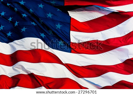 an American flag background waving in the wind - stock photo