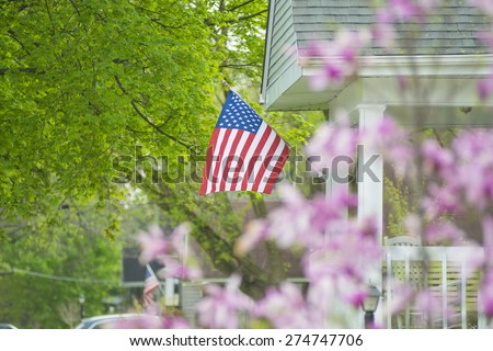 An American flag out in the spring time. - stock photo