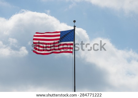 An American home proudly displaying their flag.