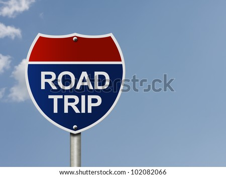 An American interstate road sign with words Road Trip over a sky background, Taking a road trip