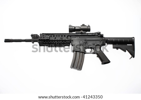 An American M4/M16 assault rifle with a red dot scope used by the military. - stock photo
