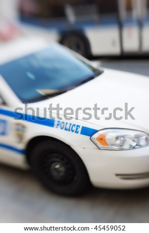 An American police car - intentional motion and lens blurred image. - stock photo