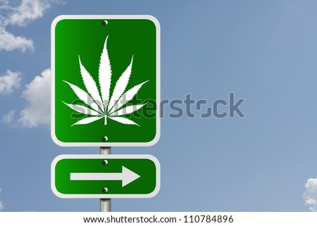 An American road sign with a sky background and marijuana leaf and arrow, Marijuana this way - stock photo
