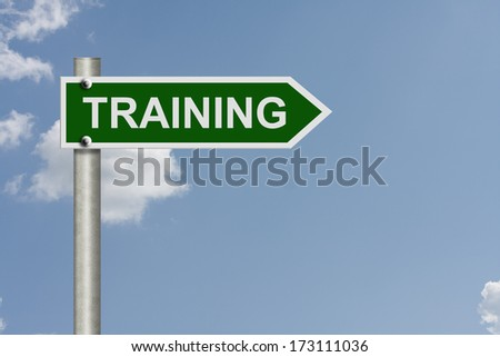 An American road sign with a sky background and word Training, Training this way