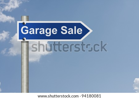 An American road signs with sky background and words garage sale, Garage Sale this way - stock photo