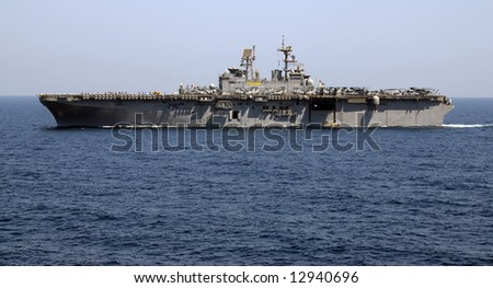 An Amphibious Assault Ship cruises the waters of the Persian Gulf - stock photo