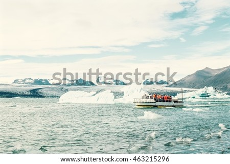 An amphibious vehicle taking tourists for a cruise around the icebergs in the Jokulsarlon glacier lake Iceland.