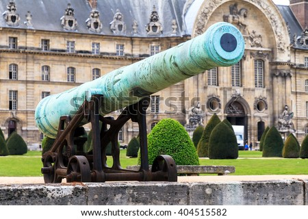 An ancient cannon at Les Invalides in Paris, France, on a beautiful day in spring - stock photo