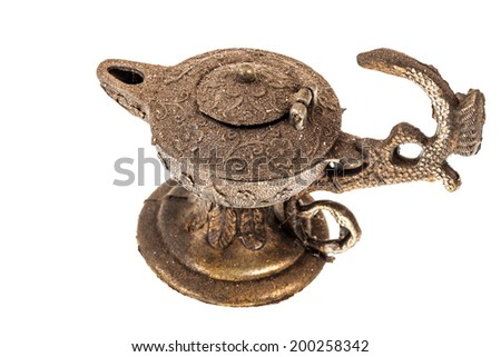 an ancient oil lamp isolated over a white background - stock photo