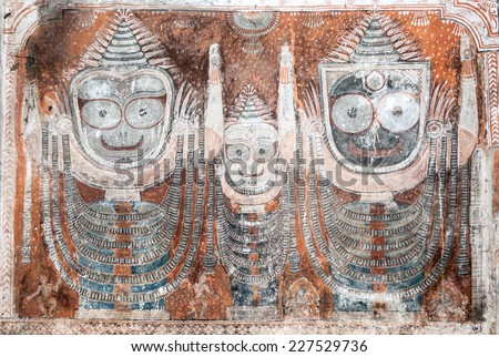An ancient painting of the Hindu god Jagannatha and his brother and sister, Balarama and Subhadra,, found in a temple in Puri, East India. - stock photo