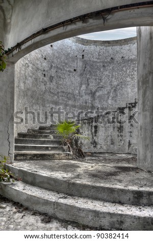 An ancient spiral staircase in an old abandoned mansion. - stock photo