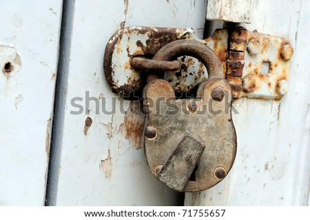 an ancient woodedn door locaked with a lock - stock photo