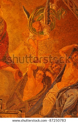 An angel heralds good news to bewildered and confused people in a gold mosaic from the basilica of Saint Mark in Venice, Italy - stock photo