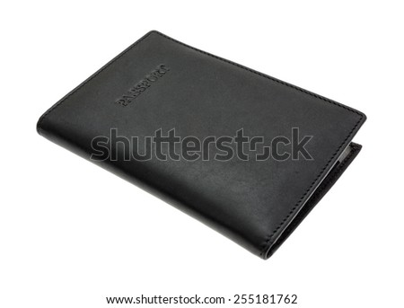 An angle side view of a black leather passport holder. - stock photo