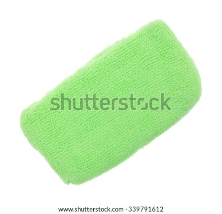 An angle top view of a lime green microfiber sponge on a white background. - stock photo