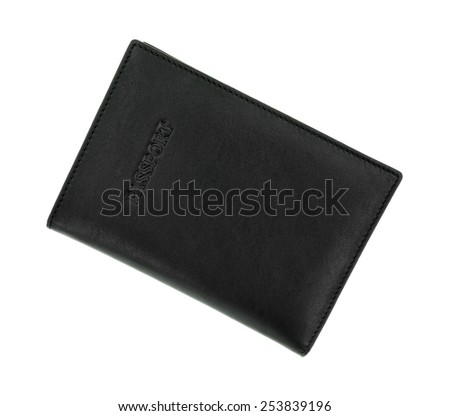 An angle view of a black leather passport holder. - stock photo