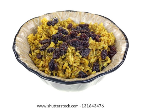 An angle view of a dish of spicy rice and raisins. - stock photo