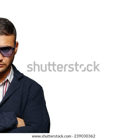 An angry guy wearing sunglasses - stock photo