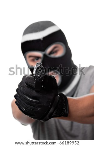 An angry looking man aiming a handgun at the viewer. Works great for crime or home security concepts. - stock photo