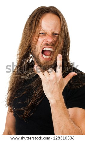An angry man with long hair screaming and doing the rock'n'roll or devil finger sign. Isolated on white - stock photo