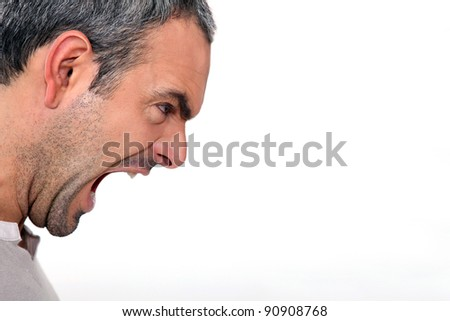 An angry man yelling - stock photo