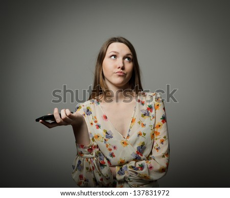 An annoyed and frustrated woman on the phone - stock photo
