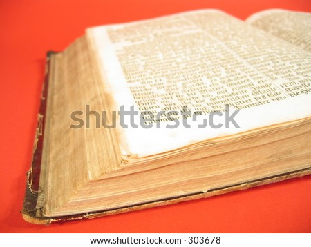 An antique book written in old German font. - stock photo
