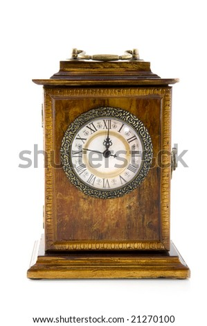an antique clock at twelve o`clock
