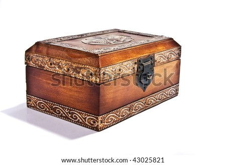 An antique engraved wooden jewelry box