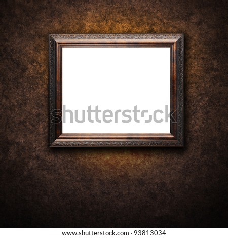An antique frame with a blank, white area for your text or image. The background has texture with dark shadows. - stock photo