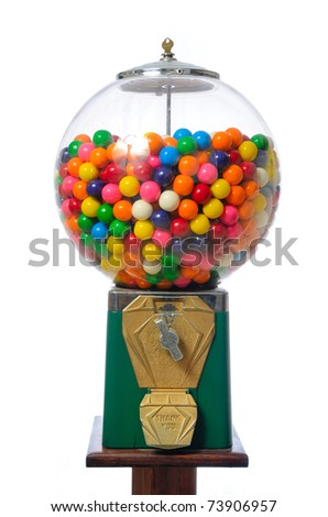 An antique gum ball machine isolated on white. - stock photo