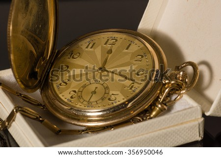 An antique pocket watch in a box - stock photo