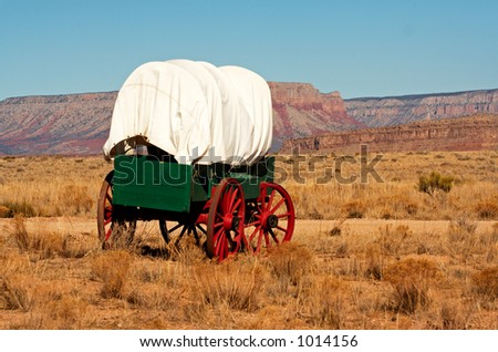 An antique wooden wagon from the wild west. - stock photo