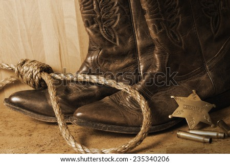 An antiqued still life on the western sheriff.  An antique technique was used and noise has been added to add a realistic effect. - stock photo