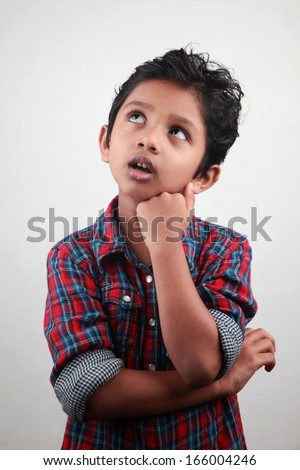 An anxious boy looking up - stock photo