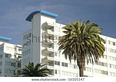 An apartment building or condo development in a tropical locale. - stock photo